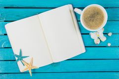 Blank notebook with cup of coffee on blue table. Cup coffee blank notebook note book table Stock Photo