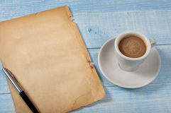Cup of coffee with a blank sheet of paper Stock Photography