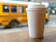 Cup of coffee blank yellow school bus usa. Cup of coffee blank against yellow school bus usa Royalty Free Stock Image