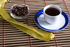 Cup of coffee with the bledets filled with grains Royalty Free Stock Photos