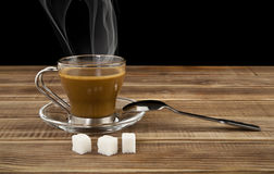 Cup of coffee and blocks of sugar Royalty Free Stock Photos