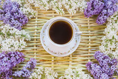 Cup of coffee and blossoming lilac Stock Photo