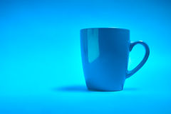 Cup of coffee on a blue background.  Stock Photo