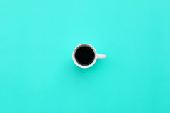 Cup of coffee on blue background.  Stock Image