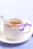 The cup of coffee on the blue backing Royalty Free Stock Photo