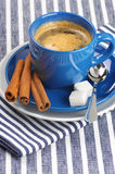 Cup of coffee. Blue cup of coffee on blue striped tablecloth Stock Photos