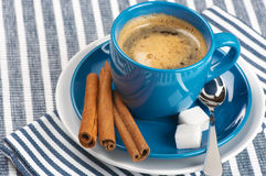 Cup of coffee. Blue cup of coffee on blue striped tablecloth Royalty Free Stock Photo