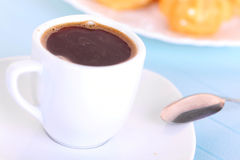 Cup of coffee on blue mat Stock Image