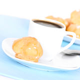 Cup of coffee on blue mat Stock Photography