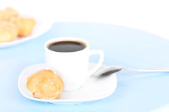 Cup of coffee on blue mat Royalty Free Stock Photography