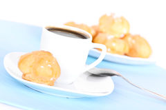 Cup of coffee on blue mat Stock Photo