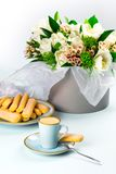 A cup of coffee on a blue saucer with Savoyardi cookies. royalty free stock photos