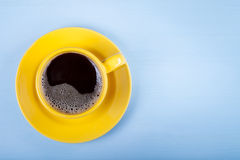 Cup of coffee on blue wooden table Stock Photo