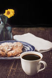Cup of coffee with blurred croissant  and flower vertical Stock Photo