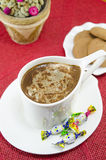Cup of coffee with bombons and biscuits Royalty Free Stock Photo