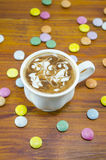 Cup of coffee and bombons of various colors Royalty Free Stock Photo