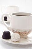 Cup of Coffee and bonbons Royalty Free Stock Photo