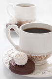 Cup of Coffee and  bonbons Royalty Free Stock Photography