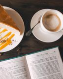 Cup of Coffee Beside Book stock photo