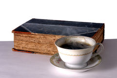 Cup of Coffee and Book. Cup of Hot Steaming Coffee and Old Book stock photography