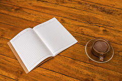 Cup of coffee with book blank Stock Images