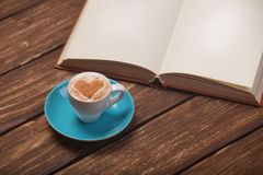 Cup of coffee with book Royalty Free Stock Photos
