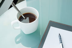 Cup of coffee with a book in the office,paper. Cup of coffee with a book in the office Stock Photo