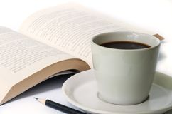 Cup of coffee and  the book. Royalty Free Stock Image