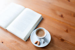 Cup of coffee and book reading Stock Photos