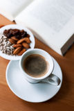 Cup of coffee and book reading Stock Image