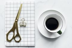 Cup of Coffee Beside Book and Scissors Stock Photo