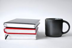 Cup of coffee and book royalty free stock photography