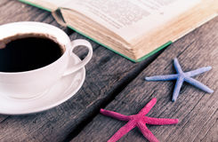 Cup Of Coffee and book on wooden background Royalty Free Stock Photography