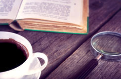 Cup Of Coffee and book on wooden background Stock Photos