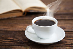 Cup of coffee and a book Royalty Free Stock Image
