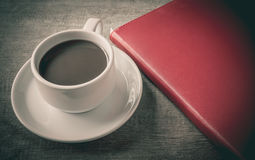Cup of coffee, book Royalty Free Stock Photos