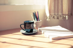 Cup of coffee and a book Royalty Free Stock Images