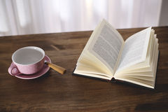 Cup of coffee with a book Stock Photography