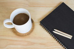 Cup coffee and booklet Royalty Free Stock Photo