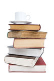 Cup of coffee on the books. Cup of coffee on the stack of books Royalty Free Stock Images