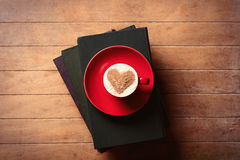 Cup of coffee and books Stock Image