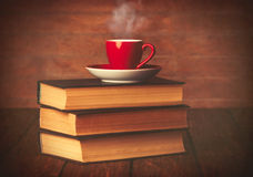 Cup of coffee and books Stock Photos