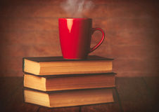 Cup of coffee and books Stock Images