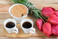 A cup of coffee and a bouquet. morning coffee flowers and coffee and flowers on the table royalty free stock photography
