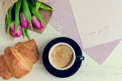 Cup of coffee with bouquet of pink tulips and notes I LOVE YOU Stock Images