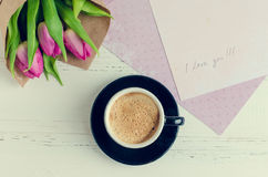 Cup of coffee with bouquet of pink tulips and notes I LOVE YOU Royalty Free Stock Photography