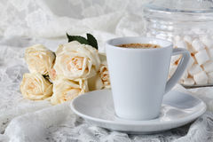 Cup of coffee and a bouquet of white roses Stock Photos