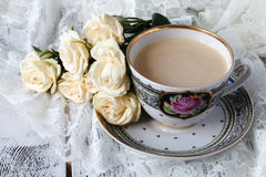 Cup of coffee and a bouquet of white roses Royalty Free Stock Photography