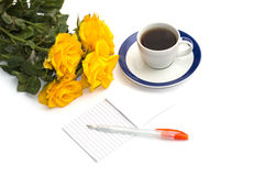 Cup of coffee, bouquet of yellow roses and notebook with the handle, the isolated image Royalty Free Stock Images