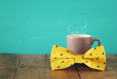Cup of coffee with bow tie. Father& x27;s day concept Royalty Free Stock Image